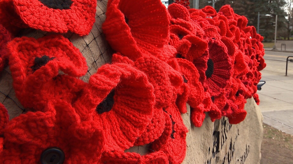 Streams of poppies have been tied to netting and draped outside and inside the Cathedral Church of the Redeemer in Calgary.