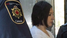 Terri-Lynne McClintic, convicted in the death of 8-year-old Woodstock, Ont., girl Victoria Stafford, is escorted into court in Kitchener, Ont., on Wednesday, September 12, 2012 for her trial in an assault on another inmate while in prison. The father of a young girl who was brutally murdered says one of her killers who was spending time in an Indigenous healing lodge is back in prison. THE CANADIAN PRESS/ Geoff Robins