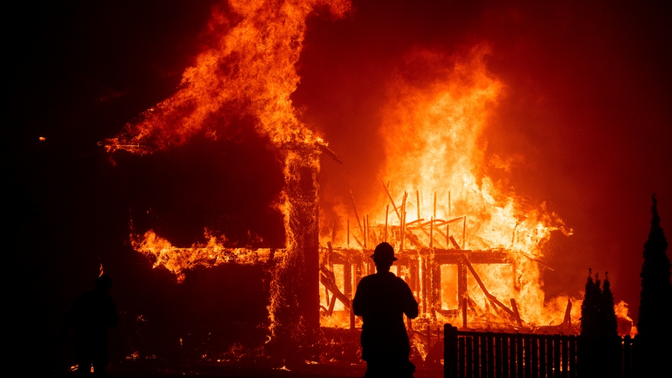 A home burns as the Camp Fire rages through Paradise, Calif., on Thursday, Nov. 8, 2018. (AP Photo/Noah Berger)