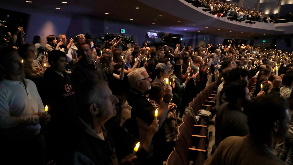People hold candles during a vigil to remember victims of a mass shooting Thursday, Nov. 8, 2018, in Thousand Oaks, Calif. (AP Photo/Marcio Jose Sanchez)