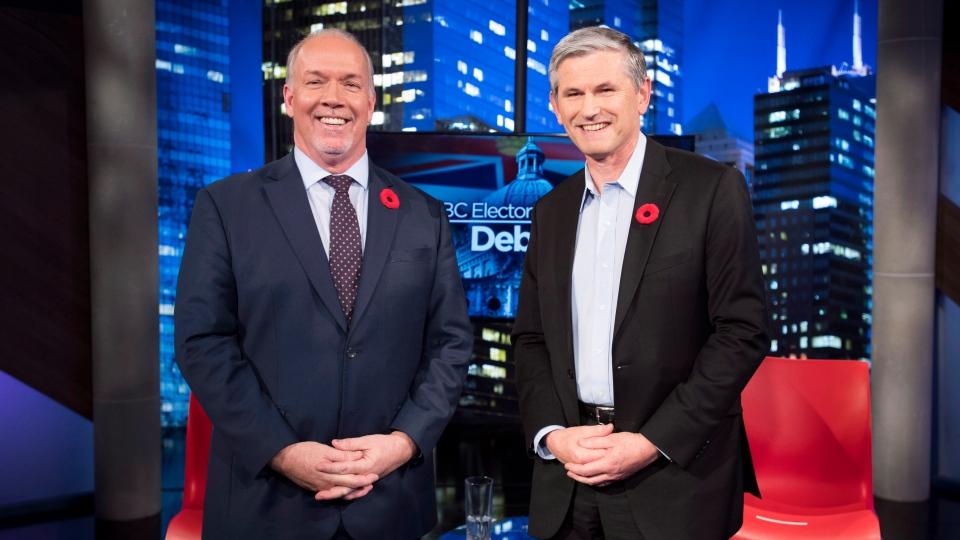 Premier John Horgan and Liberal leader Andrew Wilkinson following the Electoral Reform Debate at Global Television in Burnaby, B.C. Thursday, Nov., 8, 2018. THE CANADIAN PRESS/Jonathan Hayward