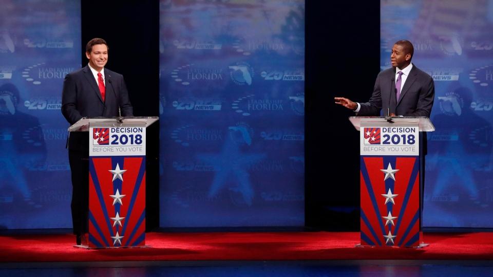 Florida gubernatorial candidates, Republican Ron DeSantis, left, and Democrat Andrew Gillum debate, Wednesday, Oct. 24, 2018, at Broward College in Davie, Fla. (AP Photo/Wilfredo Lee, Pool)