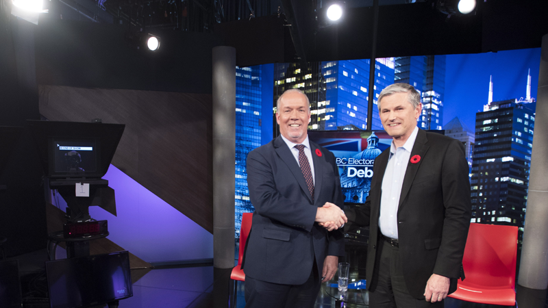 Premier John Horgan and Liberal leader Andrew Wilkinson following the Electoral Reform Debate in Burnaby, B.C. on Nov., 8, 2018. (THE CANADIAN PRESS/Jonathan Hayward)