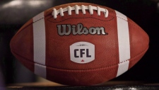 A football with the new CFL logo sits on a chair during a press conference in Winnipeg, Friday, November 27, 2015. The CFL playoffs begin Sunday and Matt Black figures it's only fitting the road to the Grey Cup begins on the same day Canada remembers those who've made the ultimate sacrifice for this country. (THE CANADIAN PRESS/John Woods)