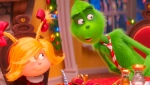 "This image released by Universal Pictures shows the characters Cindy-Lou Who, voiced by Cameron Seely, left, and Grinch, voiced by Benedict Cumberbatch, in a scene from ""The Grinch."" (Universal Pictures via AP)"