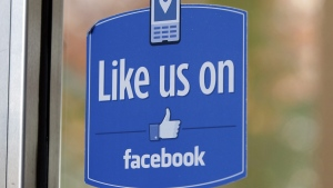 "In this Dec. 13, 2011 file photo, a sign with Facebook's ""Like"" logo is posted at Facebook headquarters near the office for the company's User Operations Safety Team in Menlo Park, Calif. (AP Photo/Paul Sakuma, File)"