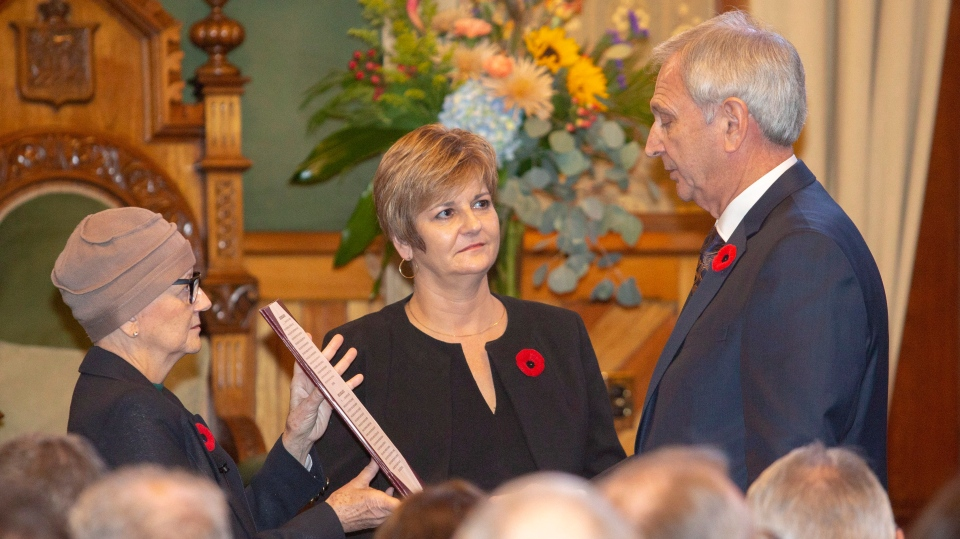 New Brunswick Progressive Conservative Leader Blaine Higgs is sworn-in as New Brunswick's 34th premier by Lt.-Gov. Jocelyne Roy-Vienneau, left, at the New Brunswick Legislature in Fredericton on Friday, Nov. 9, 2018. (THE CANADIAN PRESS/James West)