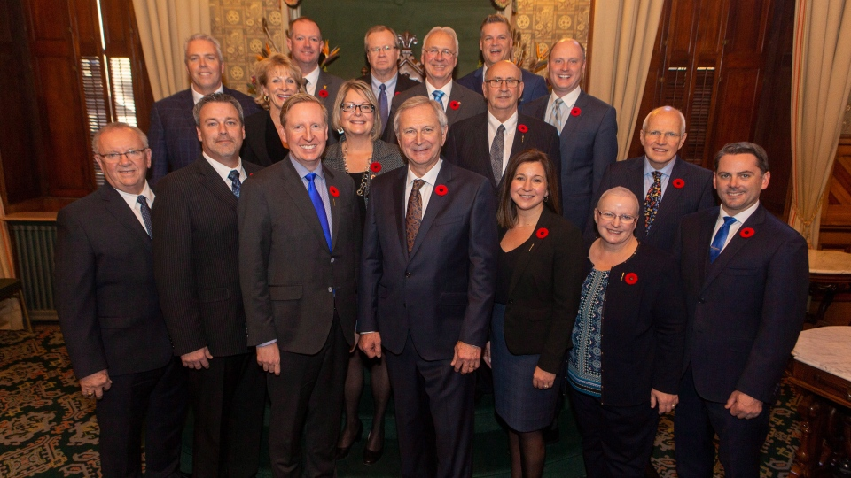 New Brunswick Premier Blaine Higgs, centre, is seen with the members of Executive Council at the New Brunswick Legislature in Fredericton on Friday, Nov. 9, 2018. (THE CANADIAN PRESS/James West)
