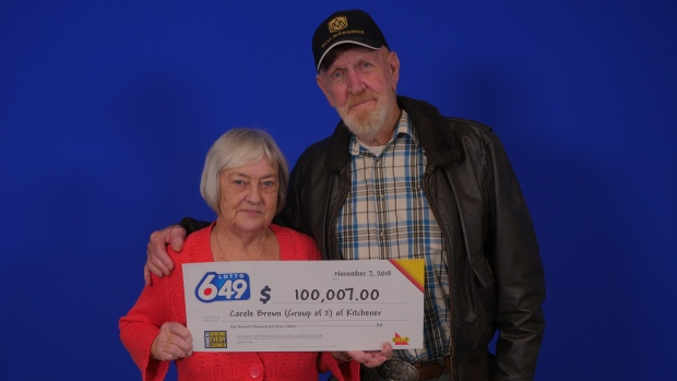 Carole Brown and James Cox with their winnings