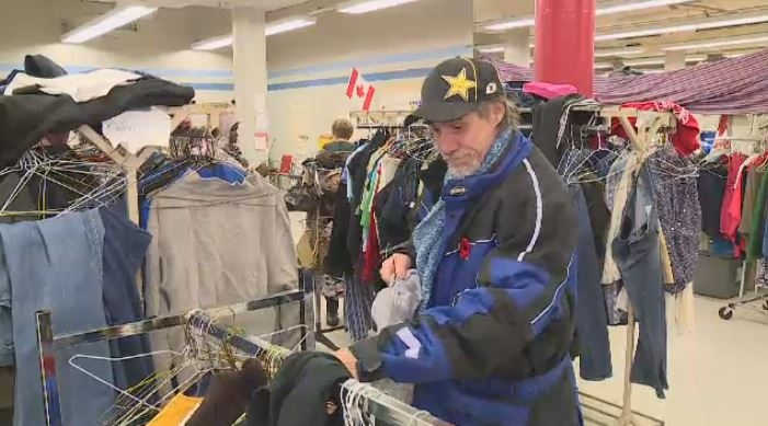 People look through jackets at Carmichael Outreach on Nov. 9, 2018