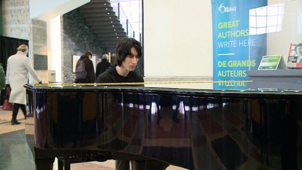 Lisgar student Aidan Prince playing piano.