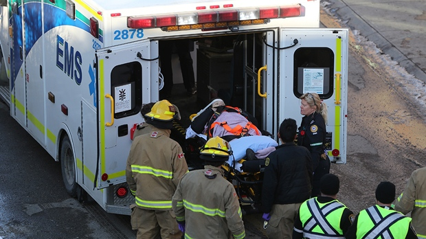 Emergency personnel attend to an injured woman who was pushed from the platform of Victoria Park/Stampede station on the afternoon of November 8, 2018 (image courtesy: Postmedia)