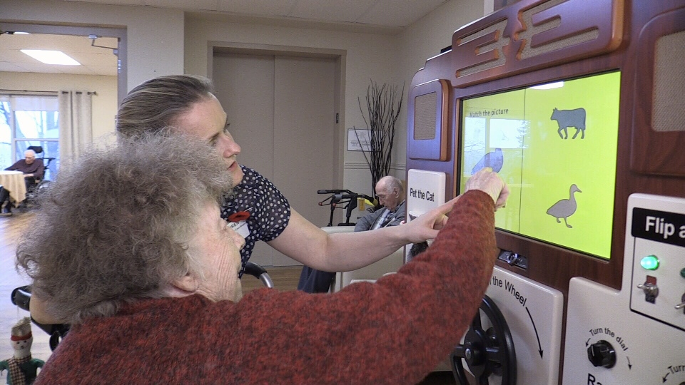Martha, a resident at the Villa Care Centre in Midland, Ont. uses new technology to trigger memories with the help of a caregiver on Friday, November 9, 2018 (CTV News/Craig Momney)