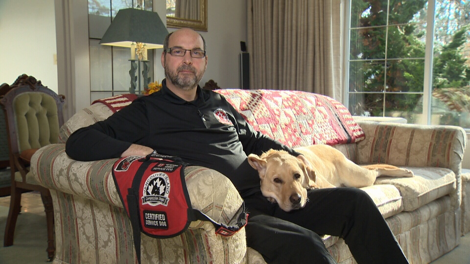 Stephane Marcotte and his psychiatric service dog Sarge are seen in Marcotte's Victoria home. (CTV Vancouver)