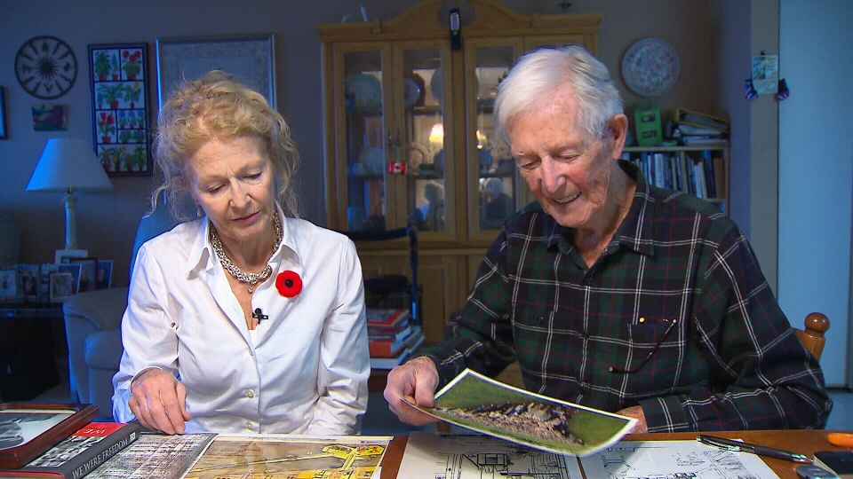 Albert Wallace, 98, and his daughter Barbara Trendos look through images and letters from the Second World War.