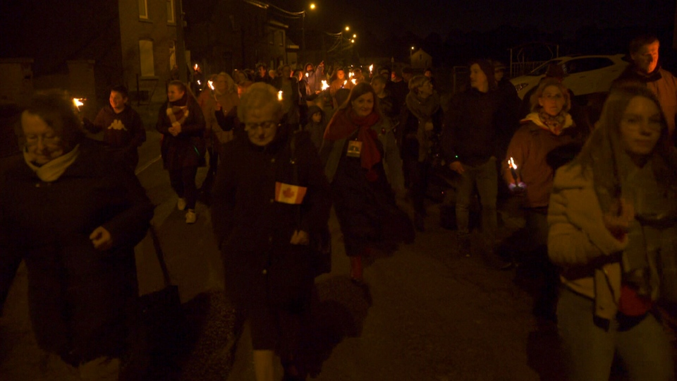 A torchlight march retraced the same route that the Canadian soldiers took to liberate the town.