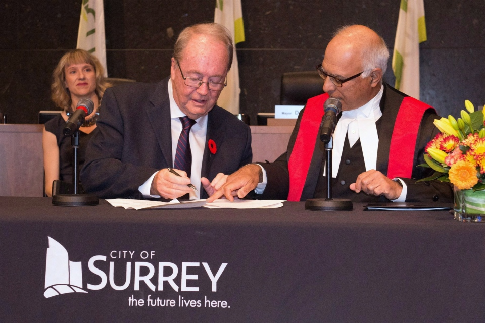 Surrey Mayor Doug McCallum, left, is sworn in during an inauguration ceremony in Surrey, B.C. on Monday, November 5, 2018 in this handout photo. THE CANADIAN PRESS/HO, Brian Dennehy, City of Surrey