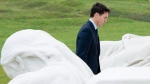 Prime Minister Justin Trudeau makes his way onto the Canadian National Vimy Memorial for a ceremony Saturday November 10, 2018 at Vimy Ridge, France. THE CANADIAN PRESS/Adrian Wyld