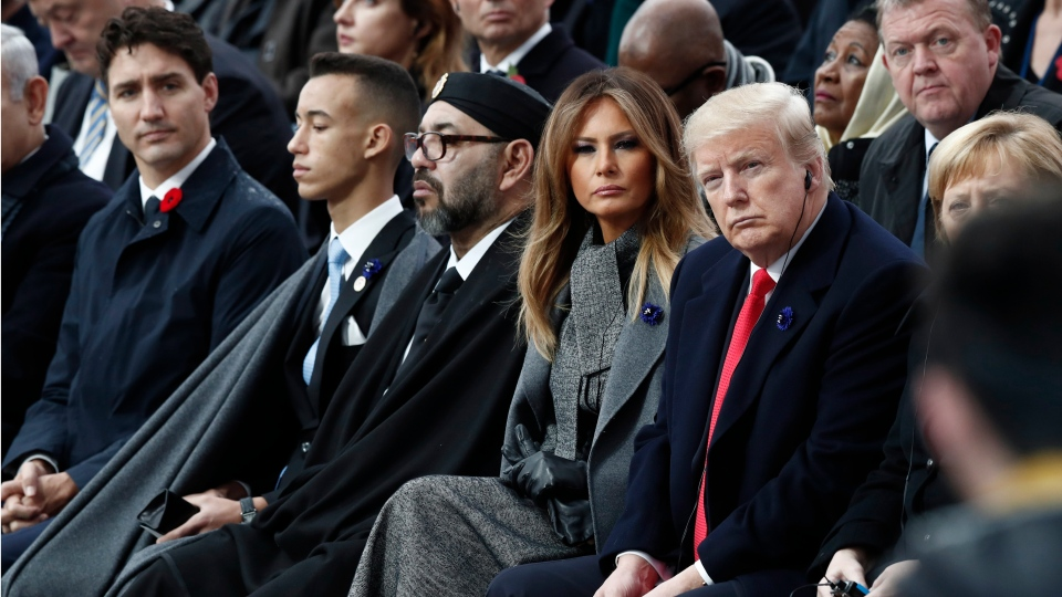 U.S. President Donald Trump, first lady Melania Trump, Morocco's King Mohammed VI, his son Crown Prince Moulay, and Canadian Prime Minister Justin Trudeau attend a commemoration ceremony for Armistice Day, 100 years after the end of the First World War at the Arc de Triomphe in Paris, France, Sunday, Nov. 11, 2018. (Benoit Tessier/Pool Photo via AP)