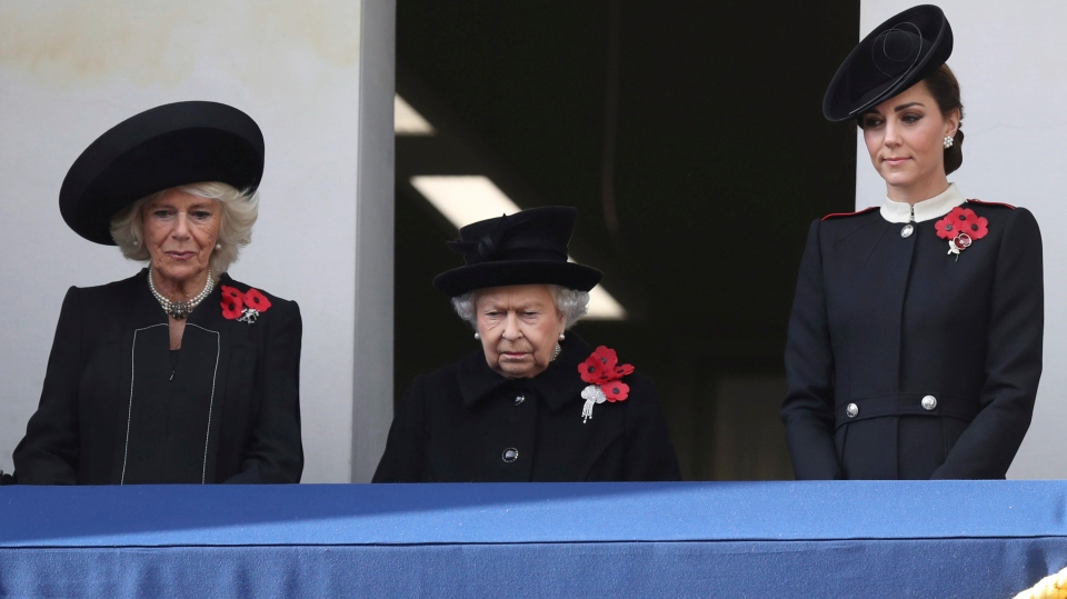 Camilla, the Duchess of Cornwall, Queen Elizabeth II and Kate,the Duchess of Cambridge stand on a balcony during the remembrance service at the Cenotaph memorial in Whitehall, central London, on the 100th anniversary of the signing of the Armistice which marked the end of the First World War, in London, Sunday, Nov. 11, 2018. (Andrew Matthews/ PA via AP)