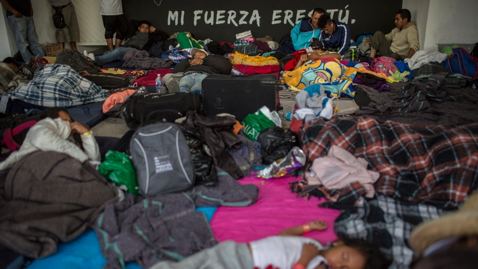 Central American migrants rest in a temporary shelter in Queretaro, Mexico, Saturday, Nov. 10, 2018.  (AP Photo/Rodrigo Abd)
