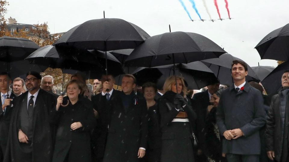 (From L) Moroccan King Mohammed VI, German Chancellor Angela Merkel, French President Emmanuel Macron and his wife Brigitte Macron and Canadian Prime Minister Justin Trudeau walk towards the Arc de Triomphe in Paris, France, as part of the commemorations marking the 100th anniversary of the 11 November 1918 armistice, ending World War I, Sunday, Nov. 11, 2018. (Ludovic Marin/Pool Photo via AP)