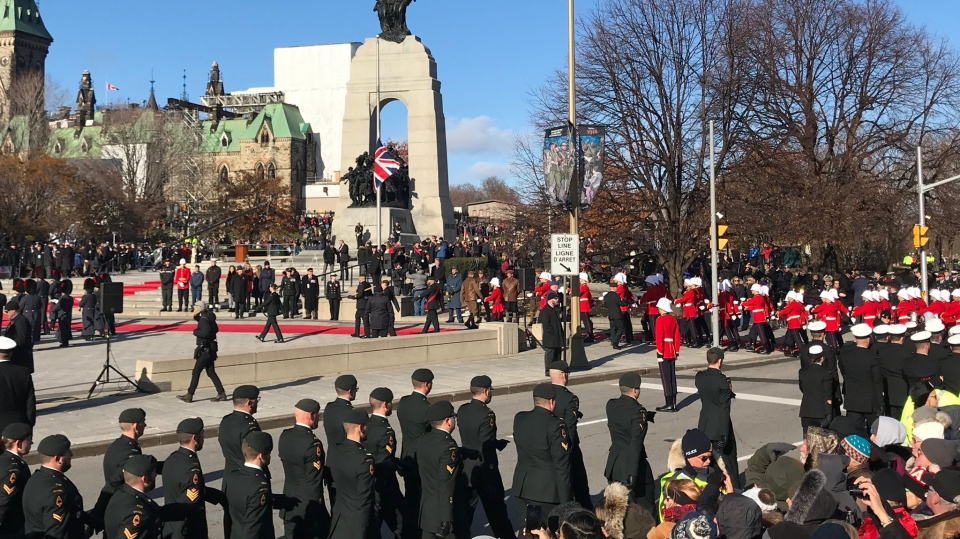 Hundreds of people gather at the National War Memorial in Ottawa for a Remembrance Day service on Sunday, Nov. 11, 2018. (Lisa LaFlamme/ CTV News)