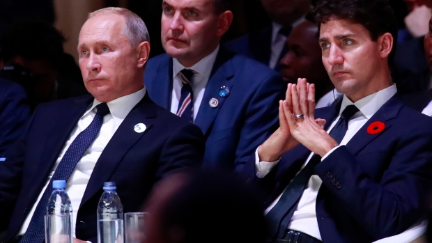 Trudeau and Putin sit side-by-side, talk Russian wartime sacrifice