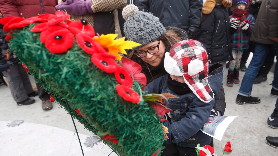 Poppies are placed on a wreath at a cenotaph during a Remembrance Day service at Vimy Ridge Memorial Park in Winnipeg, Sunday, November 11, 2018. (THE CANADIAN PRESS/John Woods)