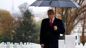 U.S. President Donald Trump stands amongst the headstones during an American Commemoration Ceremony, Sunday, Nov. 11, 2018, at Suresnes American Cemetery near Paris. (AP / Jacquelyn Martin)