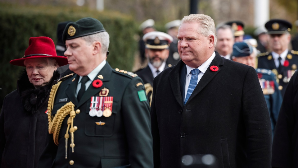 Lieutenant Governor of Ontario, Elizabeth Dowdeswell and Ontario Premier Doug Ford are led to their seats during the Ceremony of Remembrance held at Queen's Park in Toronto, on Sunday, November 11, 2018. THE CANADIAN PRESS/Christopher Katsarov