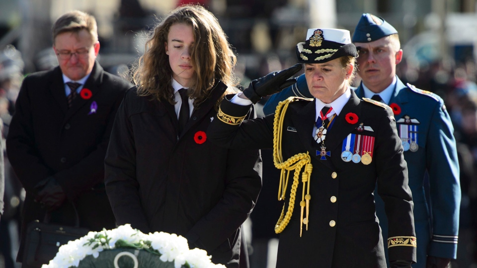 Governor General Julie Payette places a wreath with her son Laurier Payette-Flynn during Remembrance Day ceremonies at the National War Memorial in Ottawa on Sunday, Nov. 11, 2018. THE CANADIAN PRESS/Sean Kilpatrick
