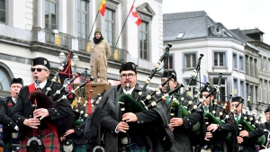 Canadian bagpipers play during Armistice commemorations in Mons, Belgium, Sunday, Nov. 11, 2018. (AP Photo/Geert Vanden Wijngaert)