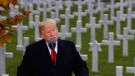 President Donald Trump speaks backdropped by headstones during an American Commemoration Ceremony, Sunday Nov. 11, 2018, at Suresnes American Cemetery near Paris. Trump is attending centennial commemorations in Paris this weekend to mark the Armistice that ended World War I. (AP Photo/Jacquelyn Martin)