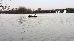 Montreal firefighters and police took to the back river early Monday Nov. 12, 2018 after people heard a woman crying for help. (CTV Montreal/Jean-Luc Boulch)