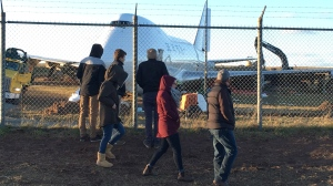 A Boeing 747 cargo jet sits off the runway near the perimeter of Halifax Stanfield International Airport in Halifax, Sunday, Nov.11, 2018. Crews have begun tearing into the mangled Boeing 747 cargo jet that overshot a Halifax runway last week, as gawkers marvelled at the huge wreck -- and how close it came to breaching the airport's fence and overrunning a public road. (THE CANADIAN PRESS/Rob Roberts)