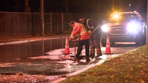 A public works crew shuts off water on Osborne St. and Wellington St. in Verdun on Nov. 12, 2018