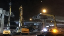 Heavy equipment is used to break up a 25-metre high roadway that used to be part of the Turcot Interchange (Photo: Transport Quebec)