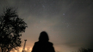 A woman observes the night sky for Leonid Meteors at an observatory near the village of Progled south of the Bulgarian capital Sofia, Tuesday, Nov. 17, 2009. The annual Leonid meteor shower is promising to put on a dazzling sky show. The Leonid meteor shower occurs each year as a result of Earth passing through dust released by the comet Tempel-Tuttle. The point from where the Leonid meteors appear to radiate is located within the constellation Leo. (AP Photo/Petar Petrov)