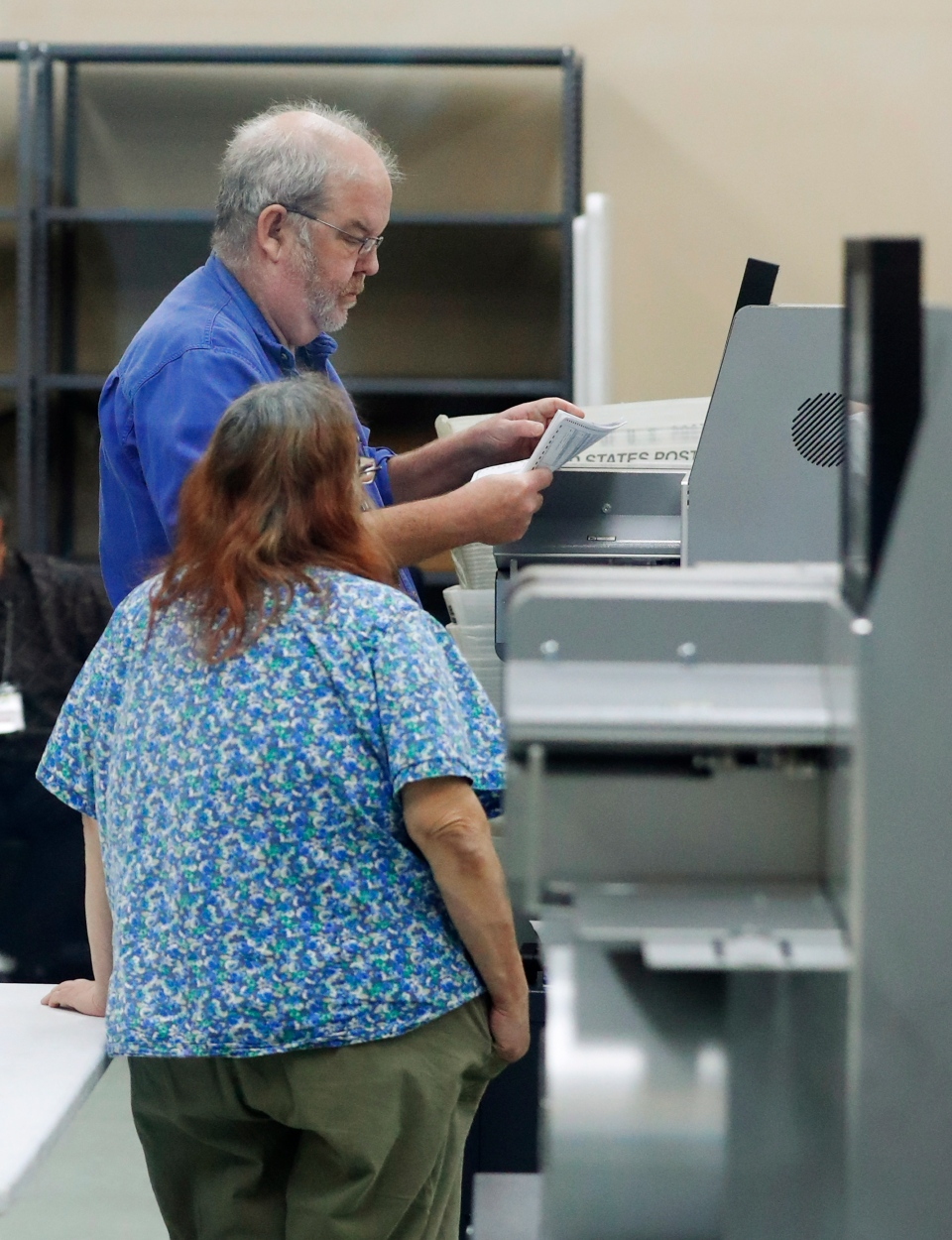 Employees at the Broward County Supervisor of Elections office calibrate machines before counting ballots, Monday, Nov. 12, 2018, in Lauderhill, Fla. (AP Photo/Wilfredo Lee)