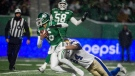 Saskatchewan Roughriders quarterback Brandon Bridge (16) is brought down by Winnipeg Blue Bombers defensive end Jackson Jeffcoat (94) during second half CFL action in Regina. The Winnipeg Blue Bombers defeated the Saskatchewan Roughriders 23-18 on Sunday, Nov 11, 2018. (CFL PHOTO - MATT SMITH)