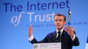 France's President Emmanuel Macron delivers a speech at the Internet Governance Forum organized at the United Nations Educational, Scientific and Cultural Organisation, UNESCO headquarters in Paris, Monday, Nov. 12, 2018. Fifty nations and over 150 tech companies are pledging to do more to fight criminal activity on the internet, including interference in elections and hate speech. (Ludovic Marin/ Pool via AP)