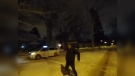 A video posted to Facebook shows a Comfort Cab driver running from his cab towards the passenger, holding a snow brush above his head. (Photo courtesy Facebook)