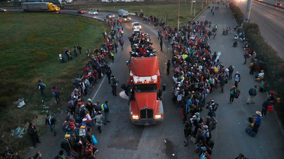 Central American migrants, part of the caravan hoping to reach the U.S. border, get a ride in a truck, in Irapuato, Mexico, Monday, Nov. 12, 2018. (AP / Marco Ugarte)