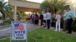 Voters line up as the polls open at David Park Community Center Tuesday, Nov. 6, 2018 in Hollywood, Fla. (Susan Stocker/South Florida Sun-Sentinel via AP)