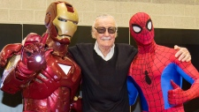 Marvel Comics legend Stan Lee strikes a pose with Iron Man and Spider-Man at HASCON, the first-ever FANmily event from Hasbro, Inc. at the Rhode Island Convention Center on Friday, Sept. 8, 2017 in Providence, R.I. (Scott Eisen / AP Images for Hasbro, Inc.)