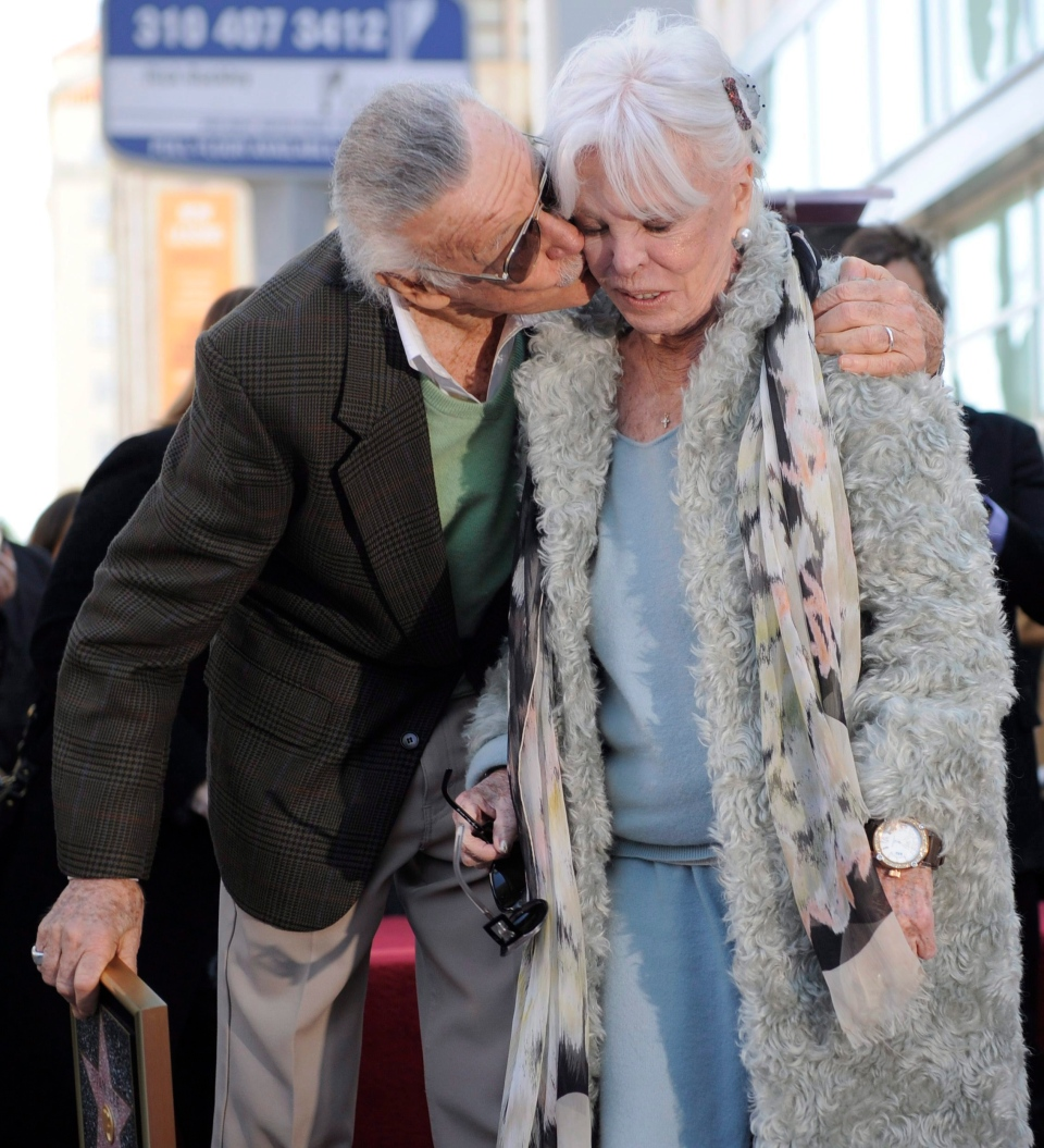 Comic book creator Stan Lee, left, kisses his wife Joan after he received a star on the Hollywood Walk of Fame in Los Angeles, Jan. 4, 2011. (AP Photo/Chris Pizzello)