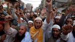Pakistani religious students attend a protest against blasphemy after the acquittal of a Christian woman, in Peshawar, Pakistan, Nov. 9, 2018. (AP Photo/Muhammad Sajjad)