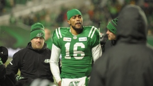 Saskatchewan Roughriders quarterback Brandon Bridge is helped off the field after a big hit in the final seconds of second half CFL West Division semifinal action against the Winnipeg Blue Bombers in Regina on Sunday, Nov. 11, 2018. THE CANADIAN PRESS/Mark Taylor