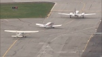 Small airplanes are seen on the runway at Buttonville Airport.